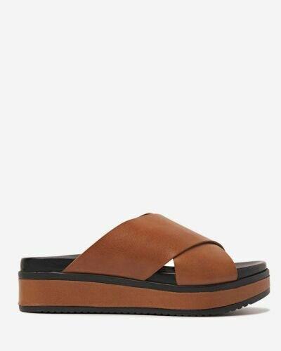 Brown slipper with leather sole